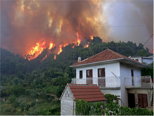Fire blankets can protect buildings from wildfires